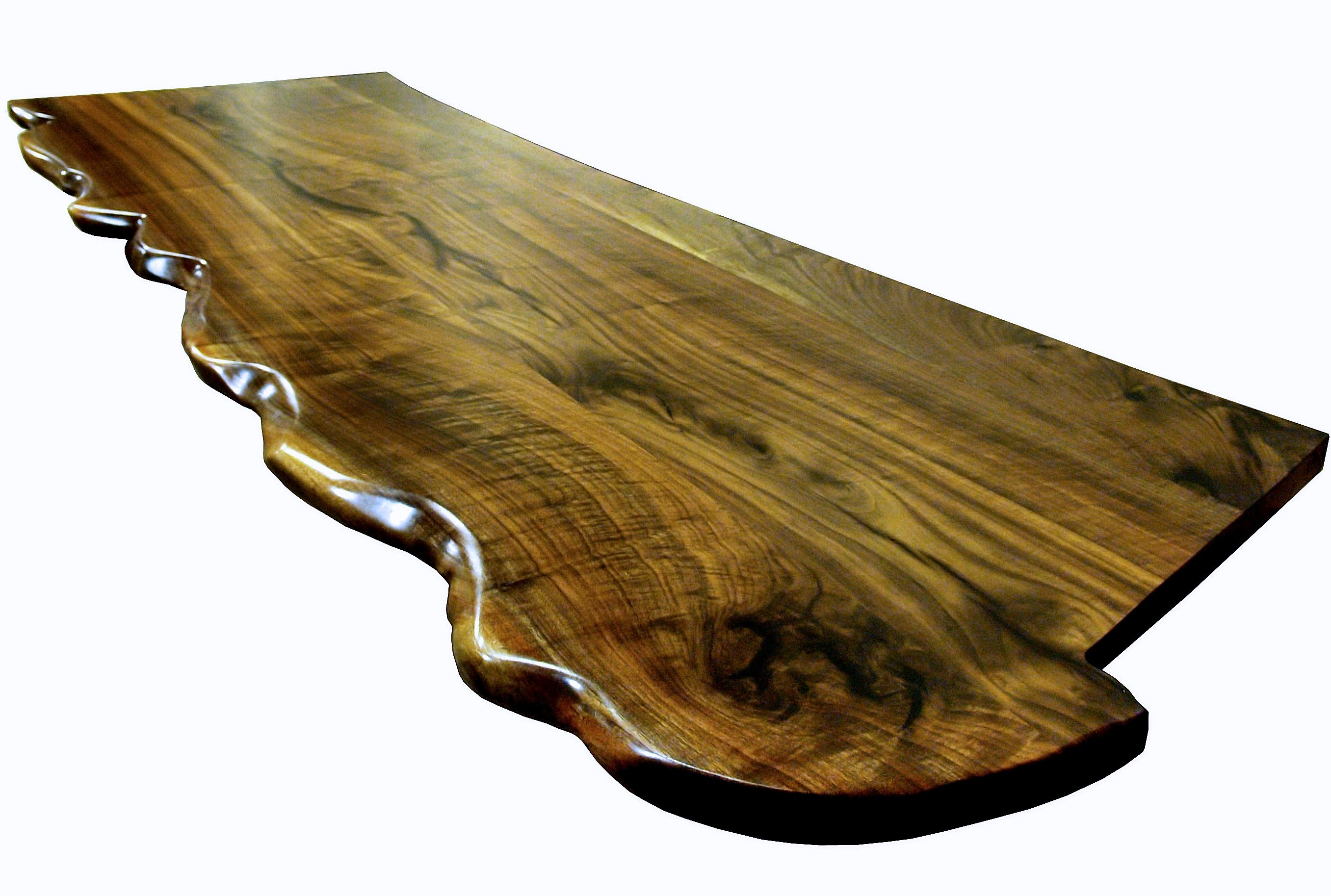 One Section Of A Multi Section Walnut Slab Bar Top. Sculpted Wane Edge And