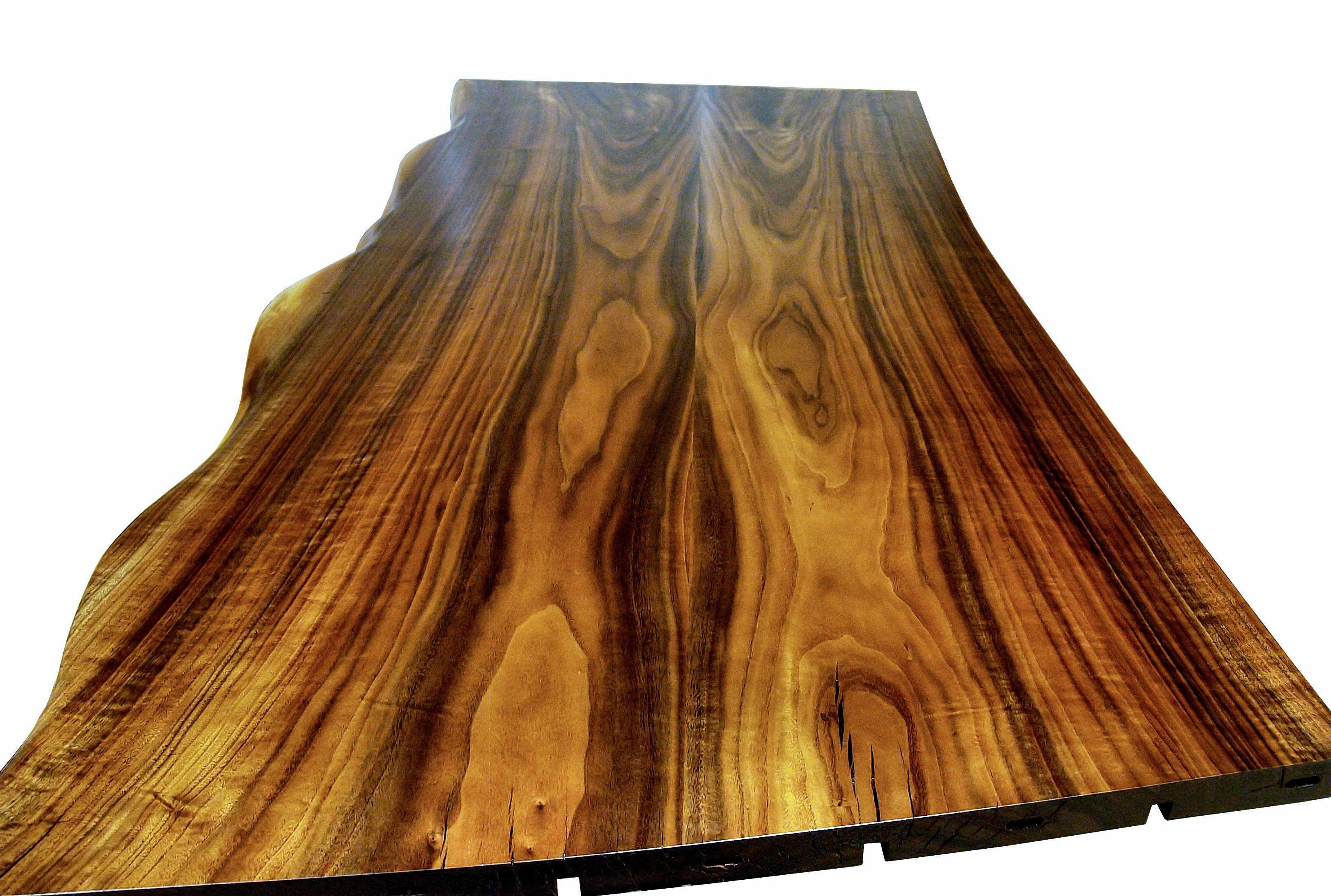 One Section Of A Multi Section Walnut Slab Bar Top. Using Book Matched