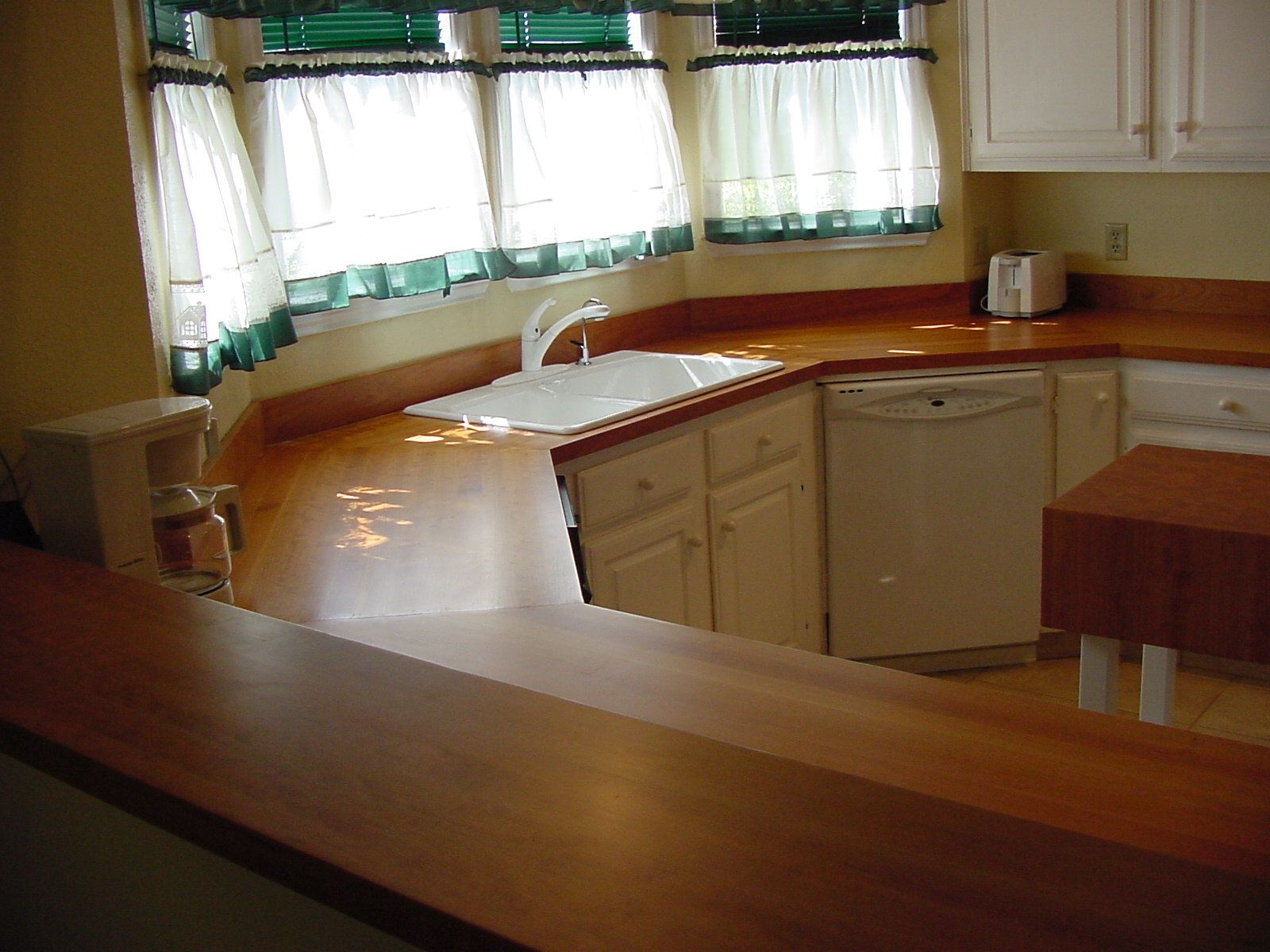Cherry Wood Countertop Photo Gallery, by DeVos Custom Woodworking on kitchen islands with wood countertops, kitchen backsplash ideas with black countertops, tile with wood countertops, kitchen backsplash ideas laminate countertops, black kitchen cabinets with wood countertops,