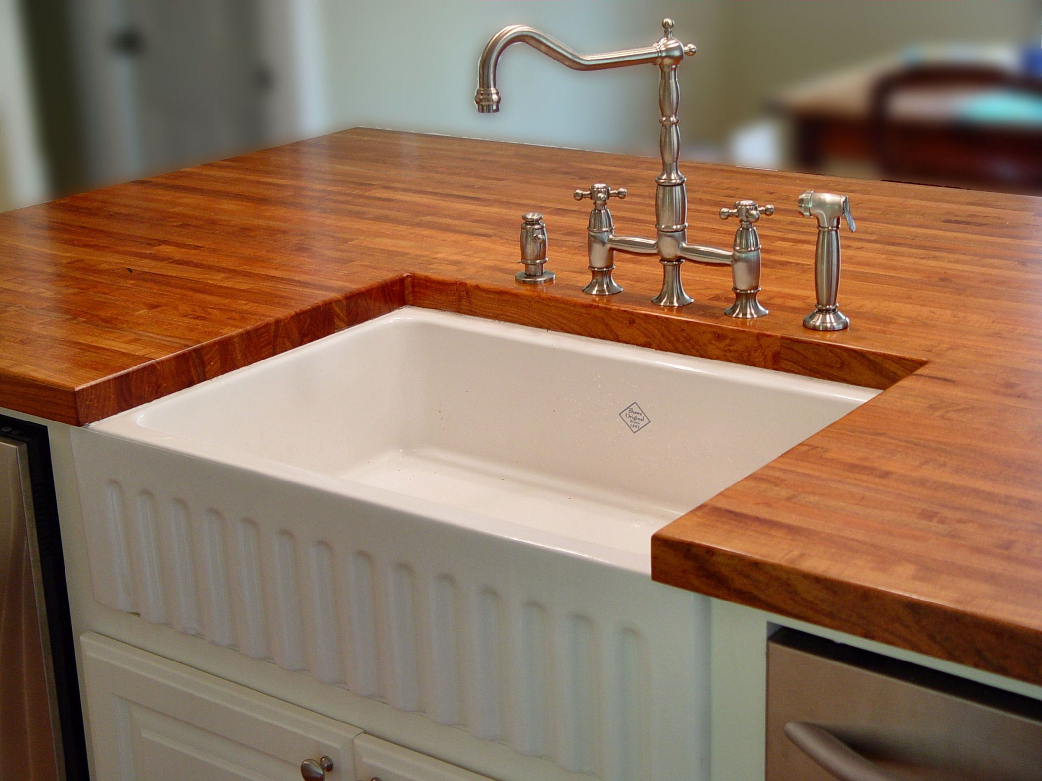 Elegant Edge Grain Mesquite Island Top With Farm Sink And Waterlox Finish