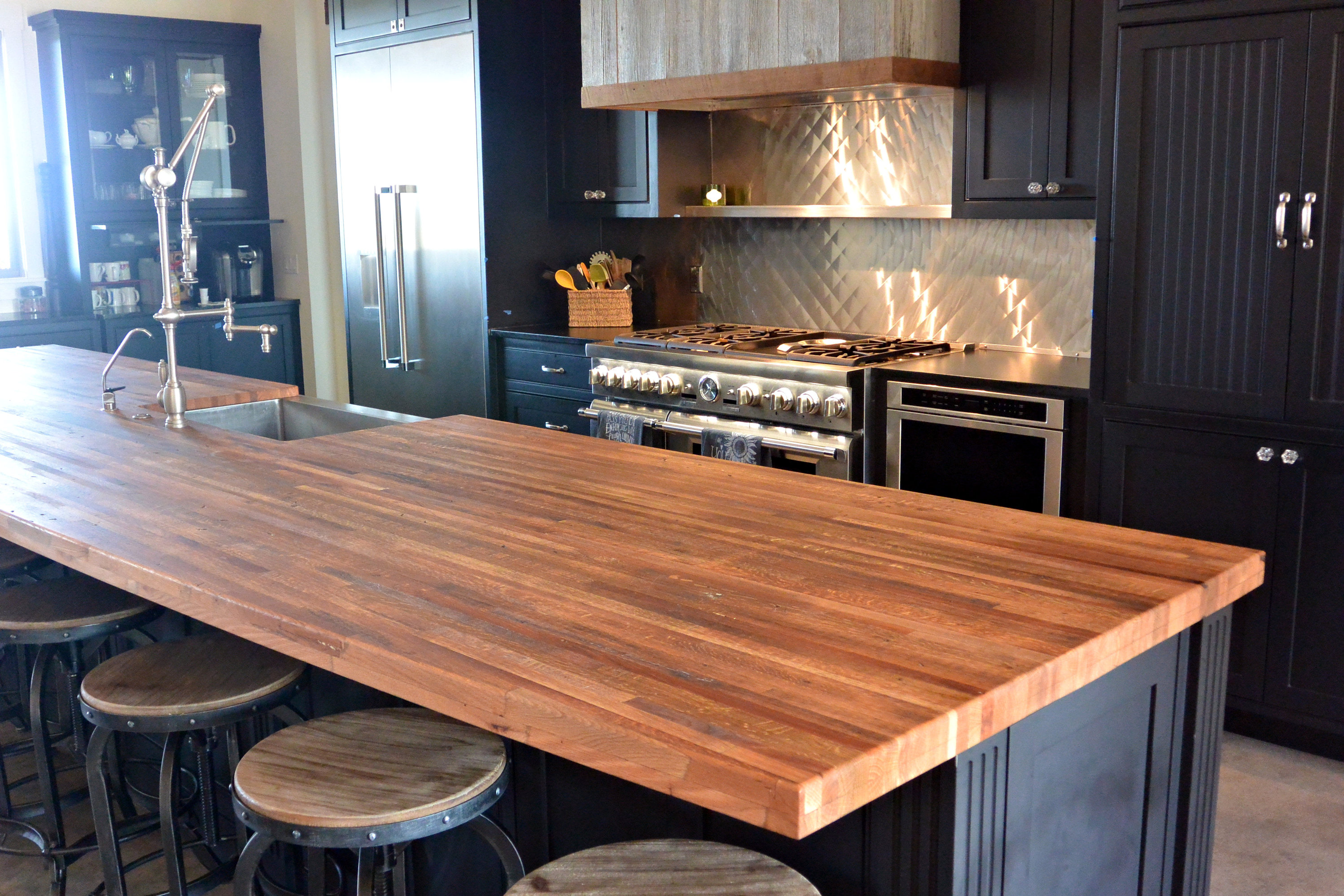 Reclaimed boxcar flooring edge grain wood island countertop with tung oil finish