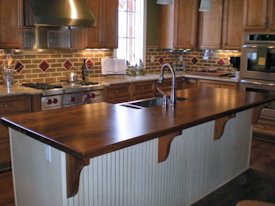 Walnut Face Grain Island Countertop With Custom Corbels.