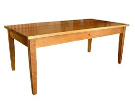 Custom Cherry shaker style dining table with drawer and walnut accents on legs.