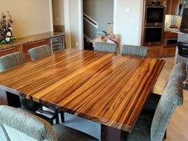 Custom Zebrawood table with a solid Wenge base.  This table also has two large leaves that are not shown.